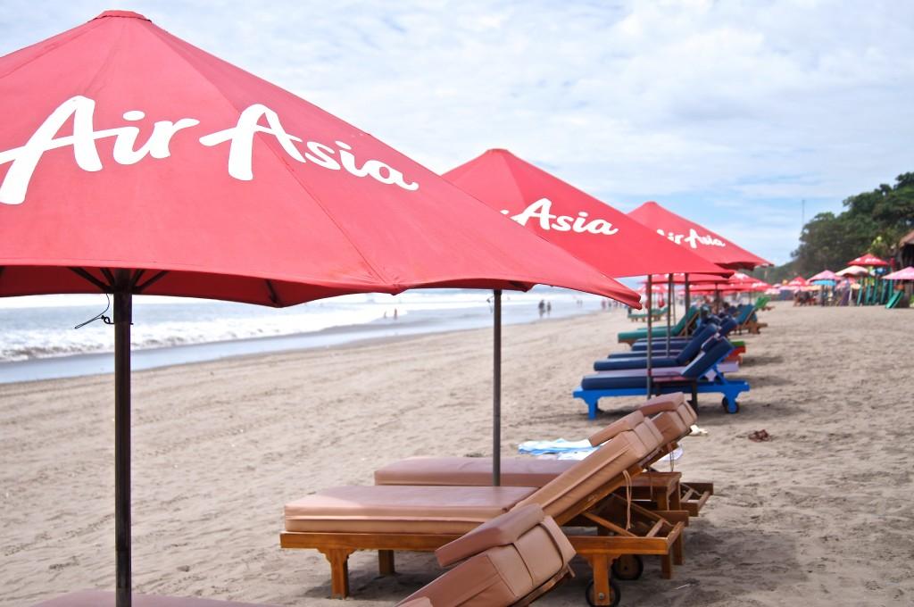 Sun loungers along the beach in Legian - Copyright