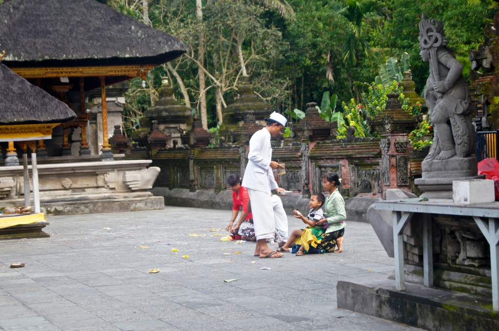 A local child receiving a blessing at the Pura Tirtha Empul Temple