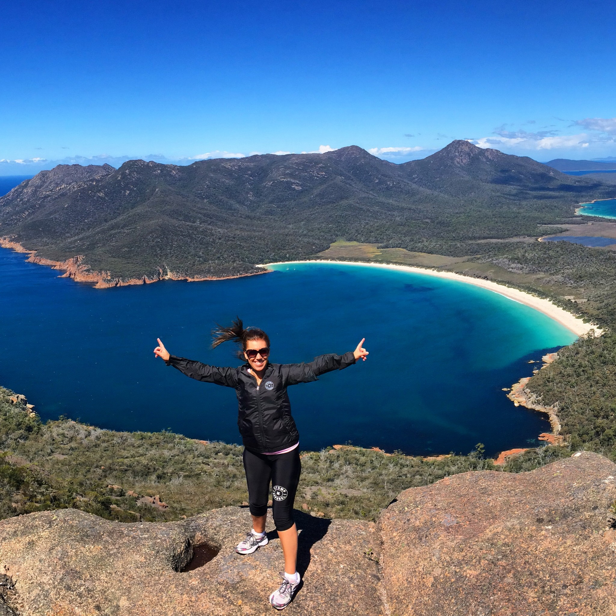 The spectacular view of Wineglass bay from the top of Mount Amos
