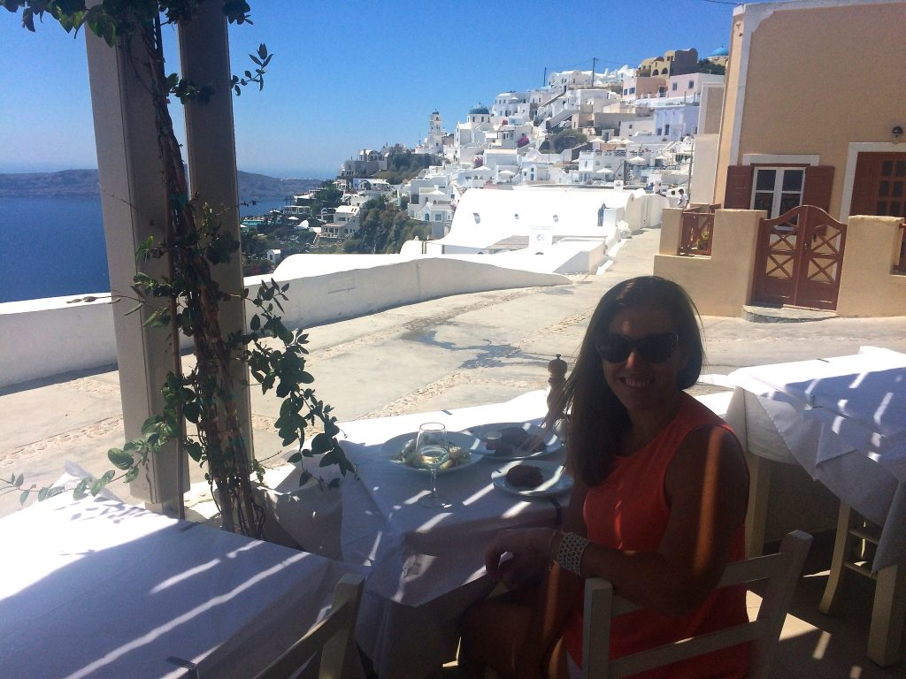 Sitting in a restaurant in Firostefani Santorini - copyright
